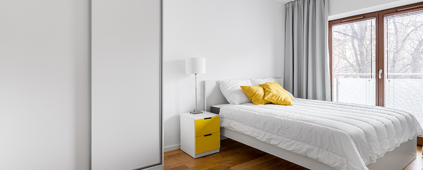 bedroom wordrobe picture with yellow cushions